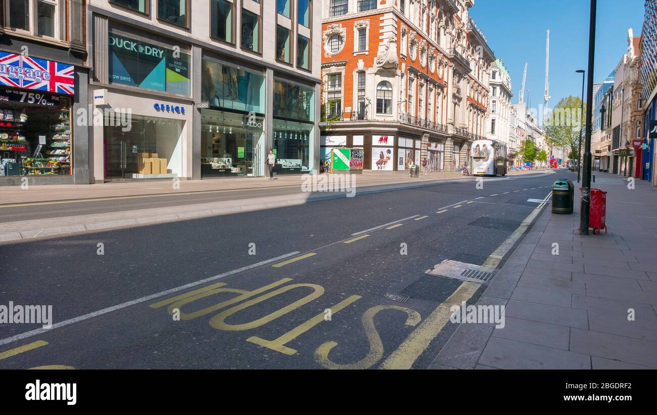 Coronavirus Pandemic a view of Oxford Street in London  April 2020. Empty pavements no tourists, all shops closed by Lockdown regulations. Stock Photo