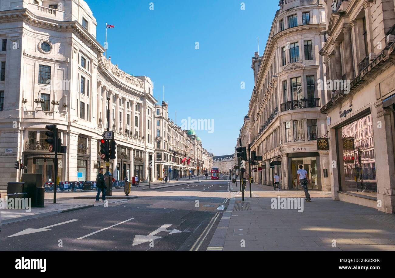 Coronavirus Pandemic a view  of Regent Street in London  April 2020. Empty pavements no tourists . all shops closed for Lockdown. Stock Photo