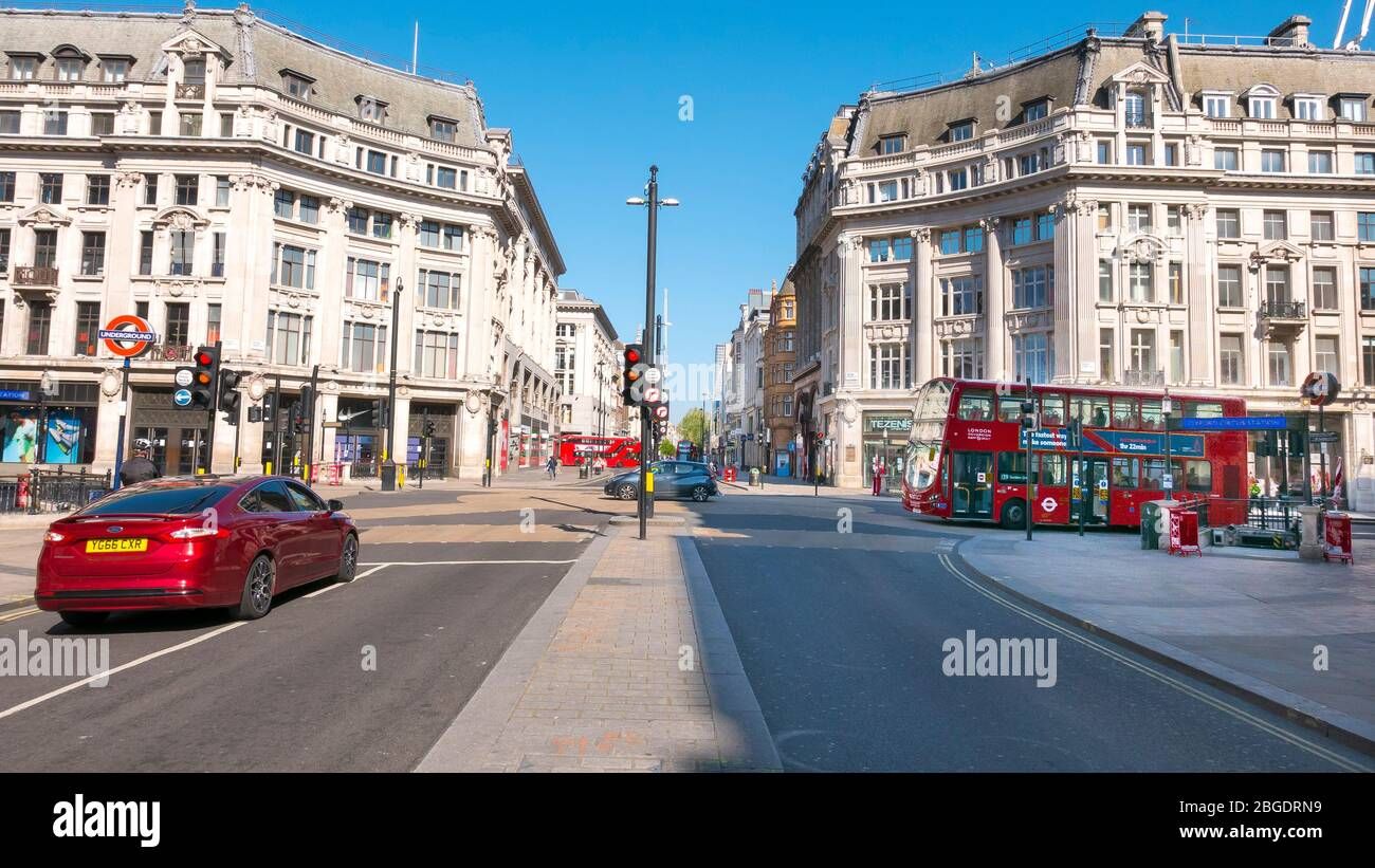 Coronavirus Pandemic a view  of Oxford Circus in London  April 2020. No people only a few buses in the streets, all shops closed for Lockdown. Stock Photo