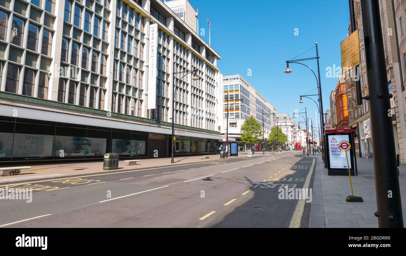 Coronavirus Pandemic a view  of Oxford Street in London  April 2020. No people only a few buses in the streets, all shops closed for Lockdown. Stock Photo