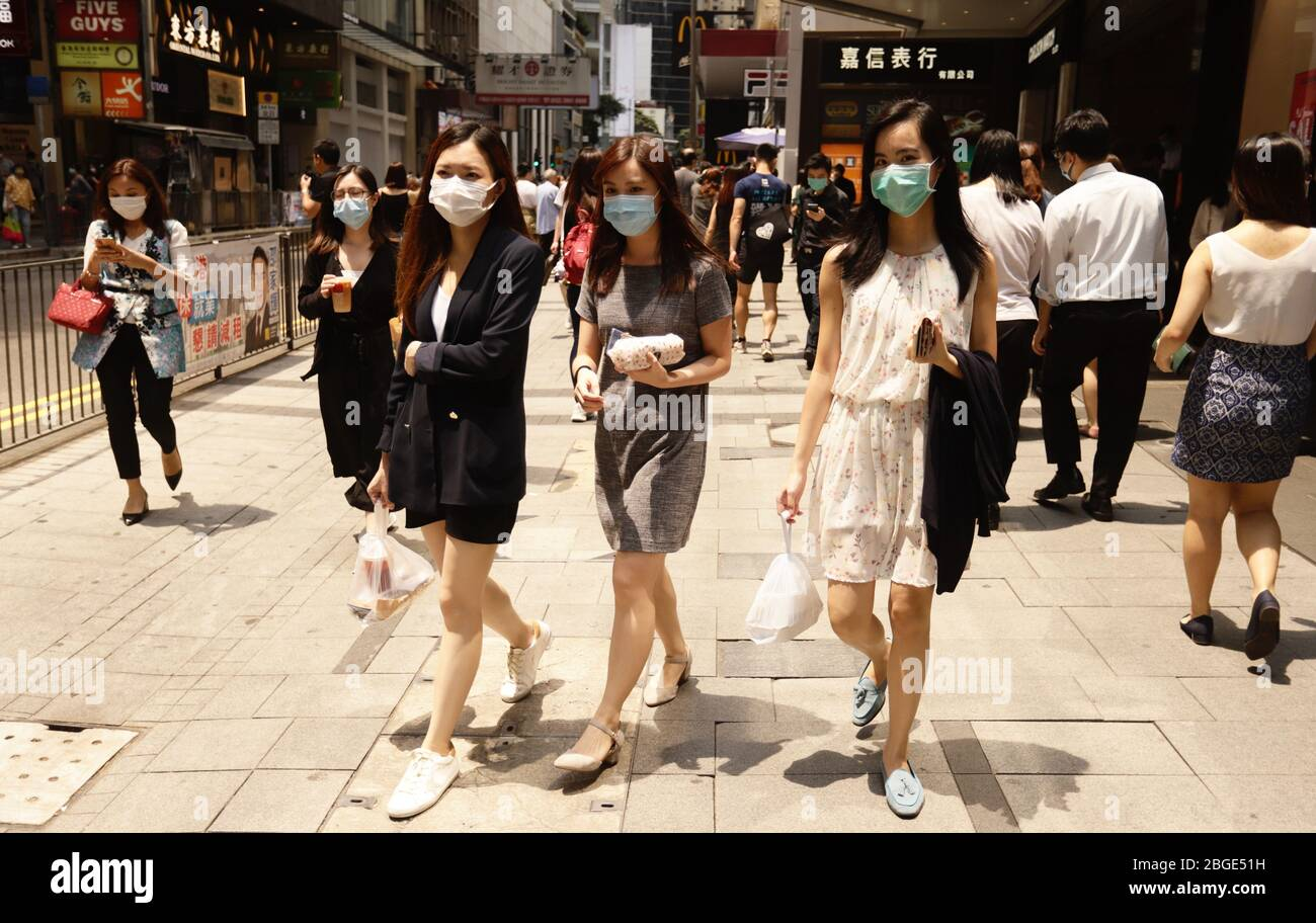 https://c8.alamy.com/comp/2BGE51H/hong-kong-china-21st-apr-2020-office-ladies-carrying-their-takeouts-during-lunch-time-in-the-financial-centre-in-centralapril-21-2020-hong-kongzumaliau-chung-ren-credit-liau-chung-renzuma-wirealamy-live-news-2BGE51H.jpg
