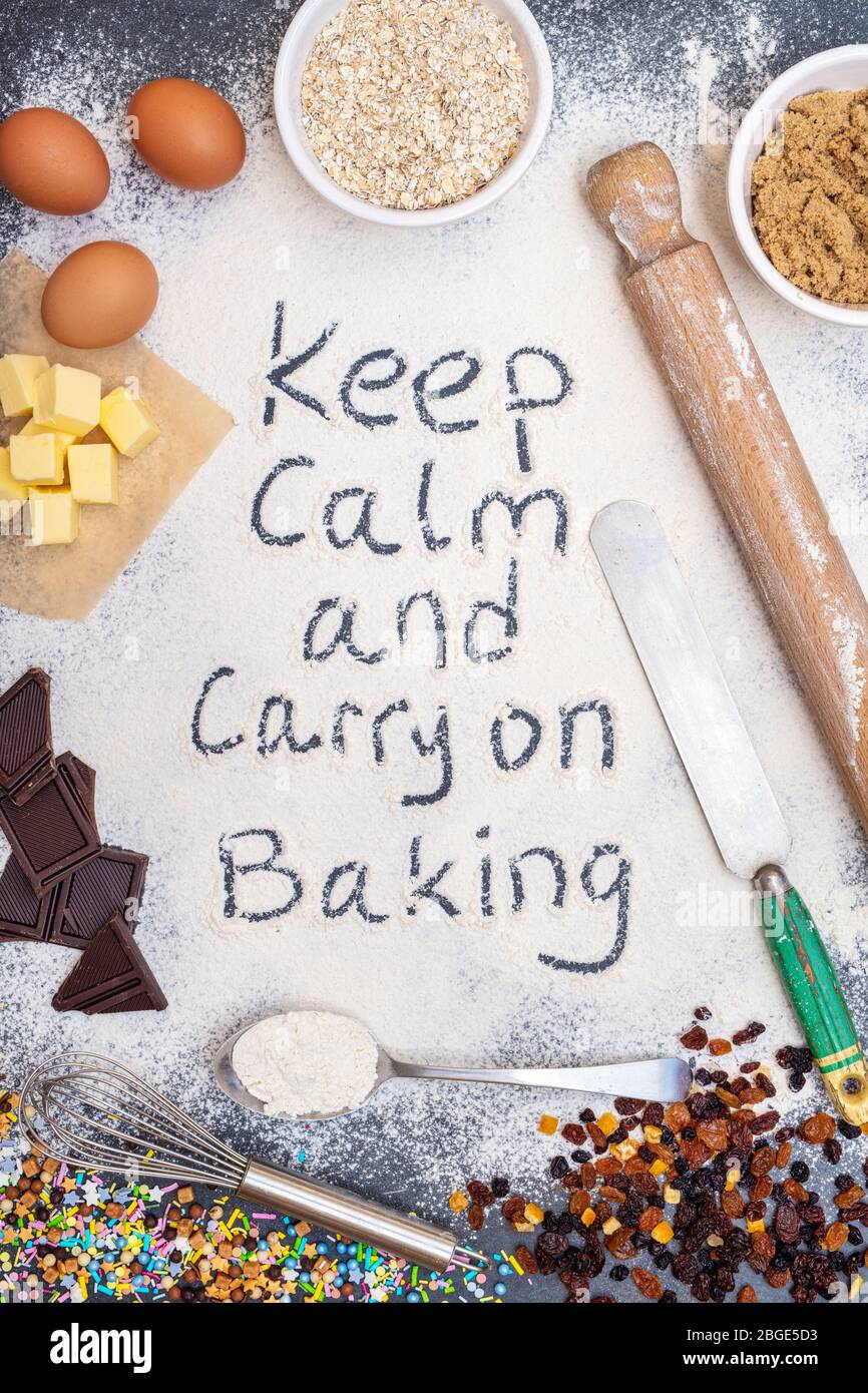 Keep calm and carry on baking written in flour with ingredients Stock Photo