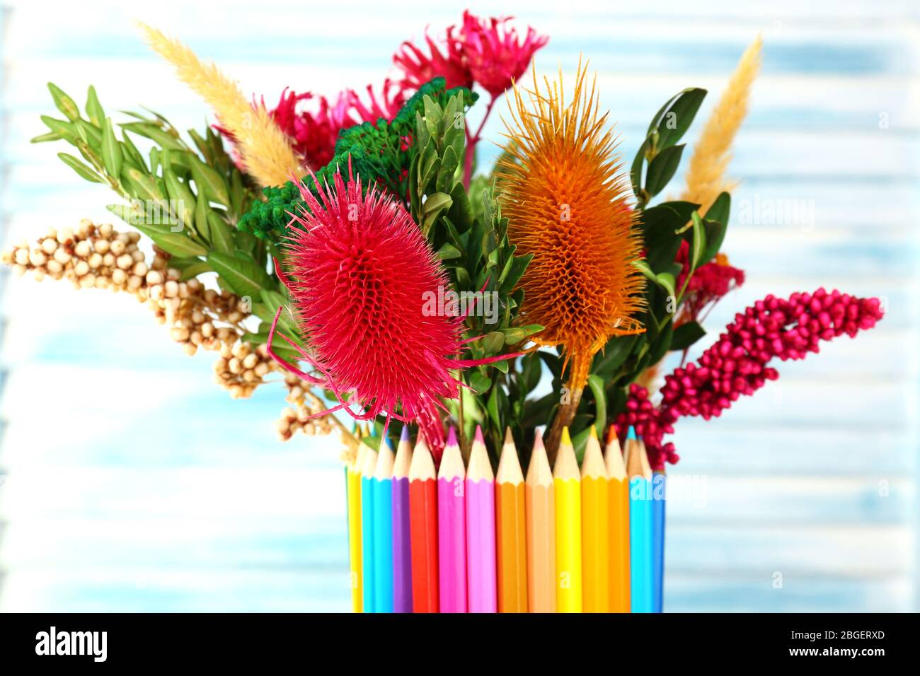 Beautiful Flowers In Colorful Pencils Vase On Wooden Background Stock Photo Alamy