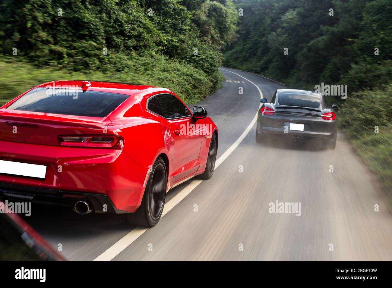 Red And Black Sport Cars Passing Each Other Speed Drive View From Behind Stock Photo Alamy