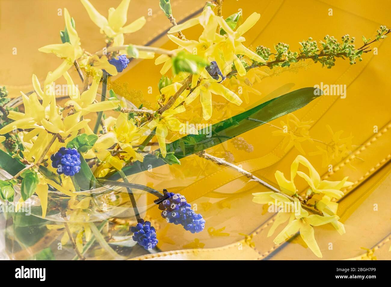 Blurred floral background, double exposure, yellow handbag and bouquet of colorful flowers, top view, selective focus. Concept of spring or summer Stock Photo