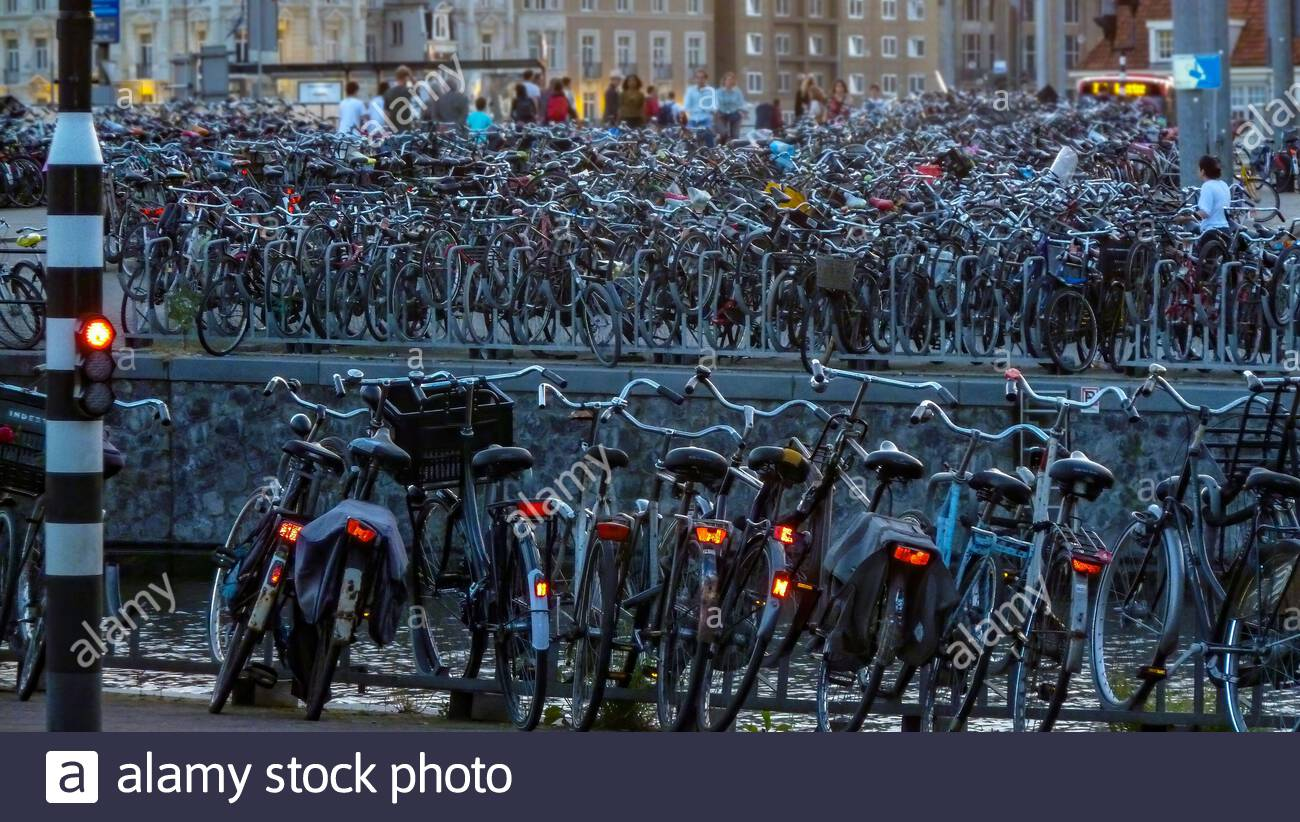 Parked bicycles in Amsterdam, Netherlands Stock Photo