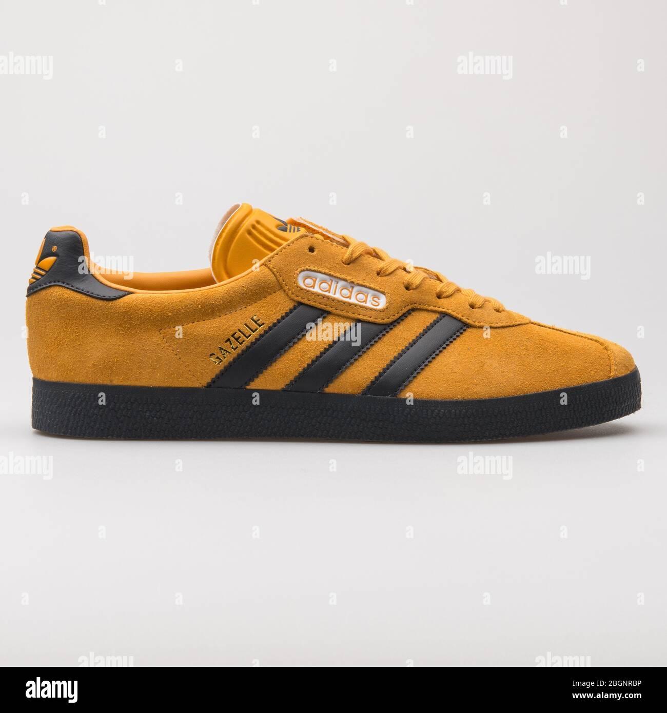 Adidas Gazelle orange and black sneaker