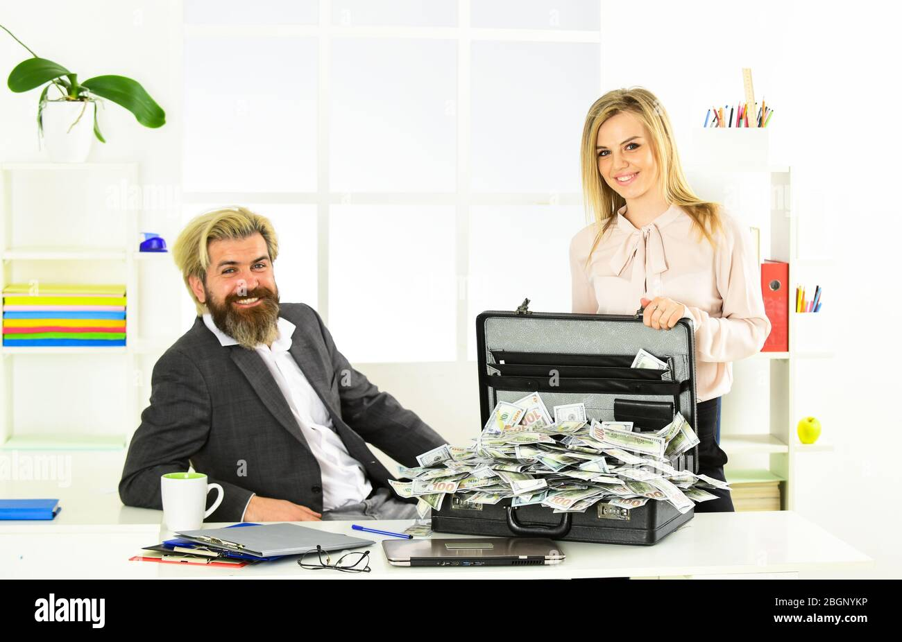 lack of money. corporate leather bag. business couple with case at workstation. happiness and success. partners holding briefcase. suitcase with money. good deal. modern life and business. Stock Photo
