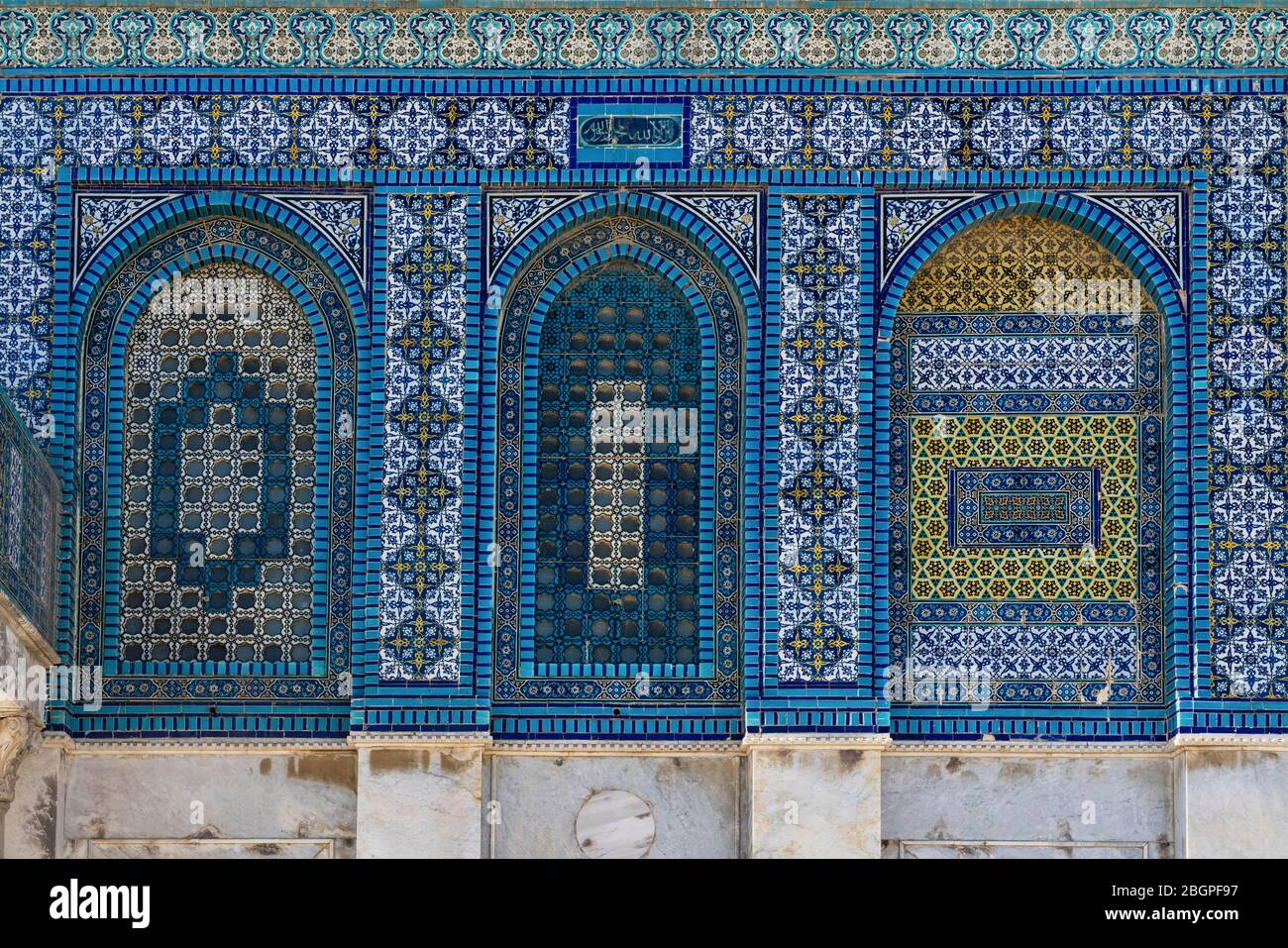 Israel, Jerusalem, al-Haram ash-Sharif, The Dome of the Rock shrine, Qubbat al-Sakhrah, is located on the Temple Mount on the site of the Soloman's Temple and was compted about 692. A.D. The Old City of Jerusalem and its Walls is a UNESCO World Heritage Site. The beautiful ceramic tile work was done during the reign of the Ottoman sultan Suleiman the Magnificent in the 1500's. Stock Photo