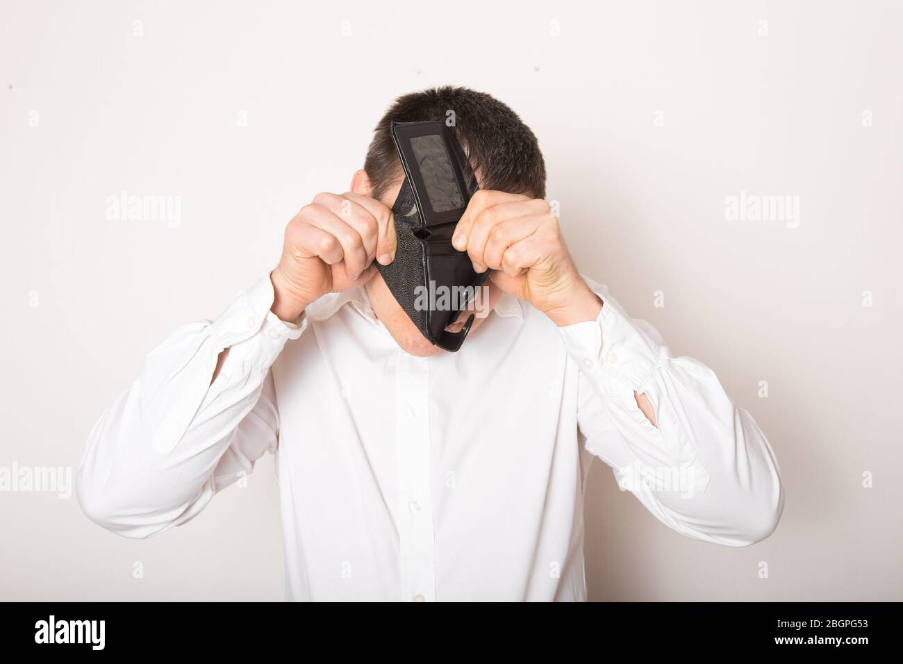 Bankruptcy - Business Person holding an empty wallet. Man showing  the inconsistency and lack of money and not able to pay the loan and the mortgage. Stock Photo