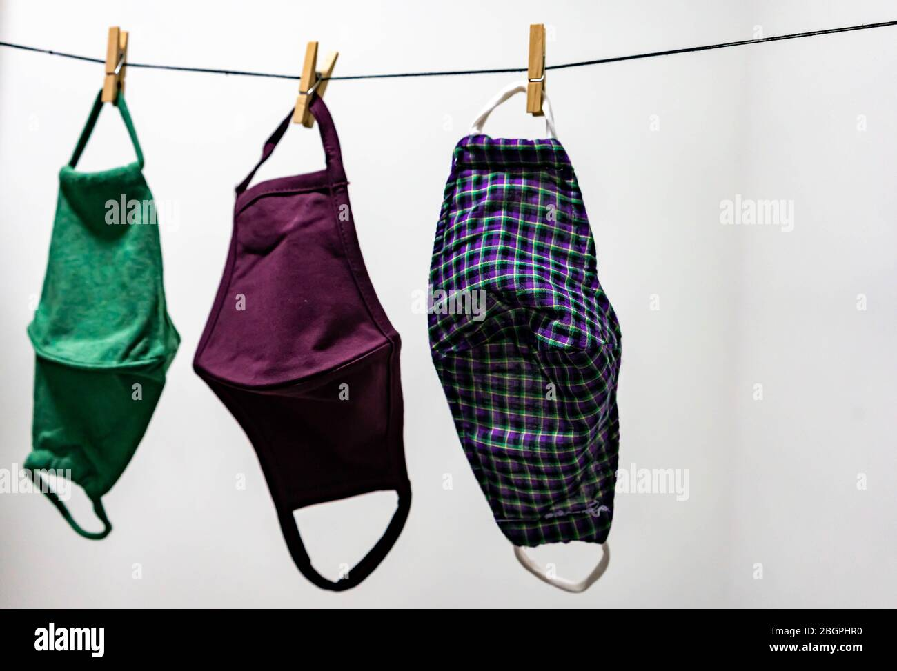 Washable face masks hanging after washing. Washable face masks to help reuse and to protect from being infected with corona covid-19 virus and other i Stock Photo