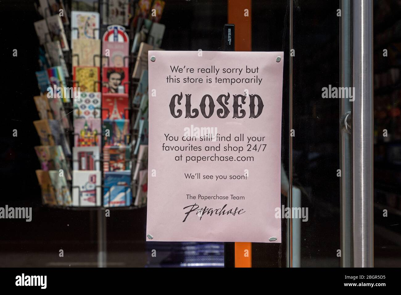 Notice on the door of Paperchase in George Street in Edinburgh informing customers that they are closing temporarily due to the Coronavirus. Stock Photo