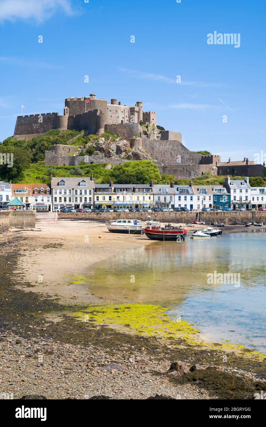 Mount Orgueil Castle overlooking the harbour and bay at low tide at Gorey on the east coast of Jersey, Channel Isles Stock Photo