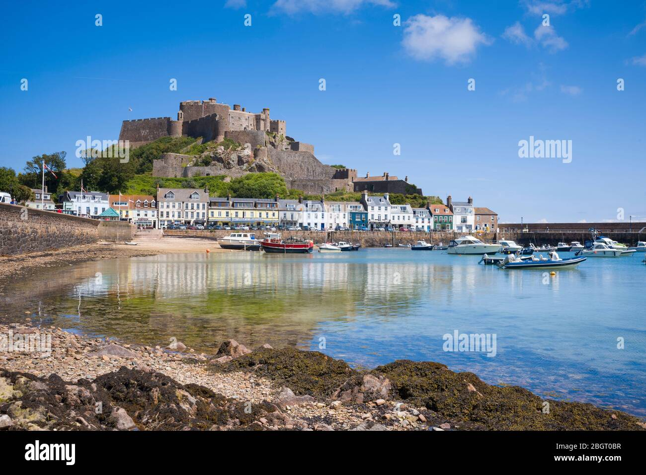 Mount Orgueil Castle overlooking the harbour and bay at Gorey on the east coast of Jersey, Channel Isles Stock Photo