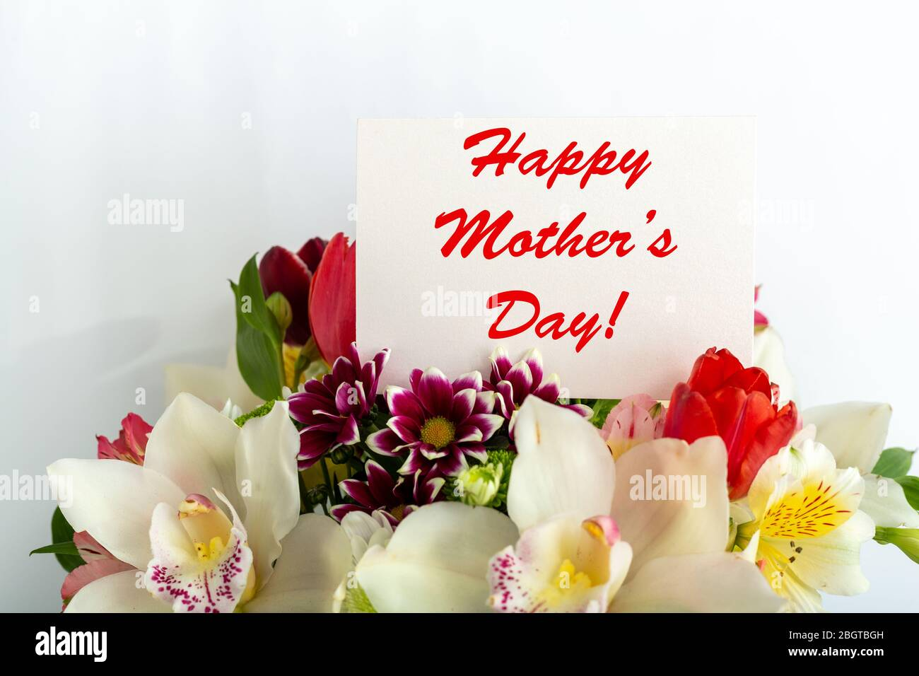 Happy Mothers Day Text On Gift Card In Flower Bouquet On White Background Greeting Card For Mom Flower Delivery Congratulations Card In Flowers For Stock Photo Alamy