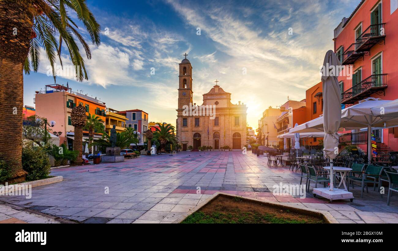 Square at Orthodox Cathedral in the old town of Chania on Crete, Greece. Trimartyri cathedral, orthodox church in port of Chania, Crete island, Greece Stock Photo