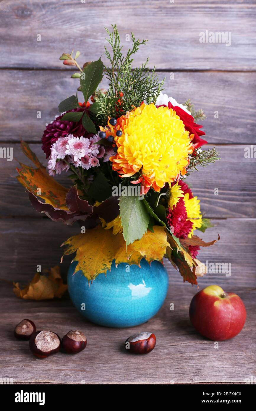 Flower Bouquet In Blue Vase On Grey Wooden Background Stock Photo Alamy