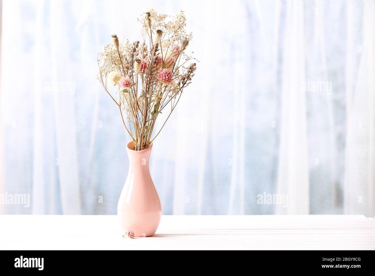 Bouquet Of Dried Flowers In Vase On Light Background Stock Photo Alamy