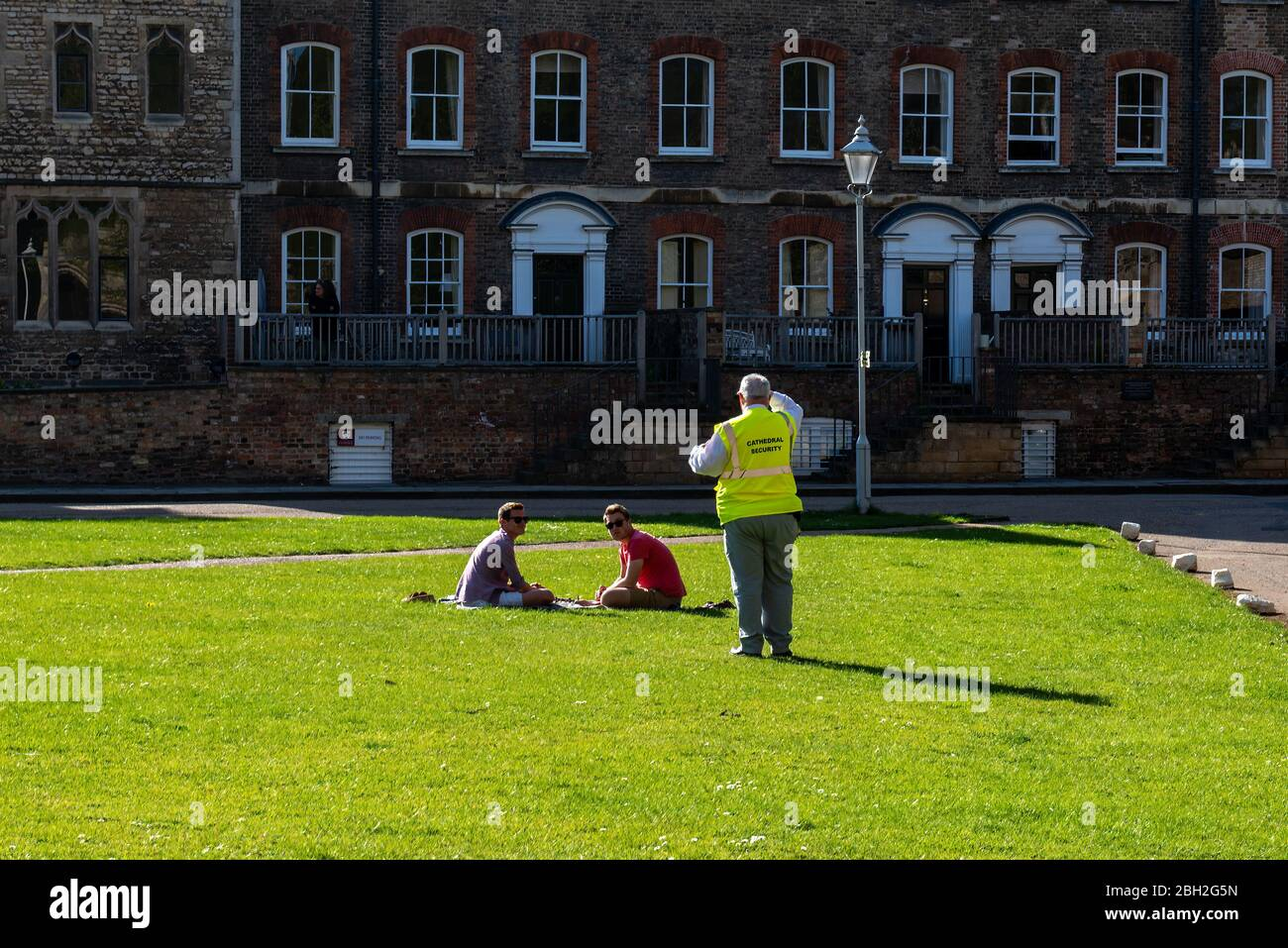 Security guard breaks up picnic of friends not adhering to social distancing guidelines Stock Photo
