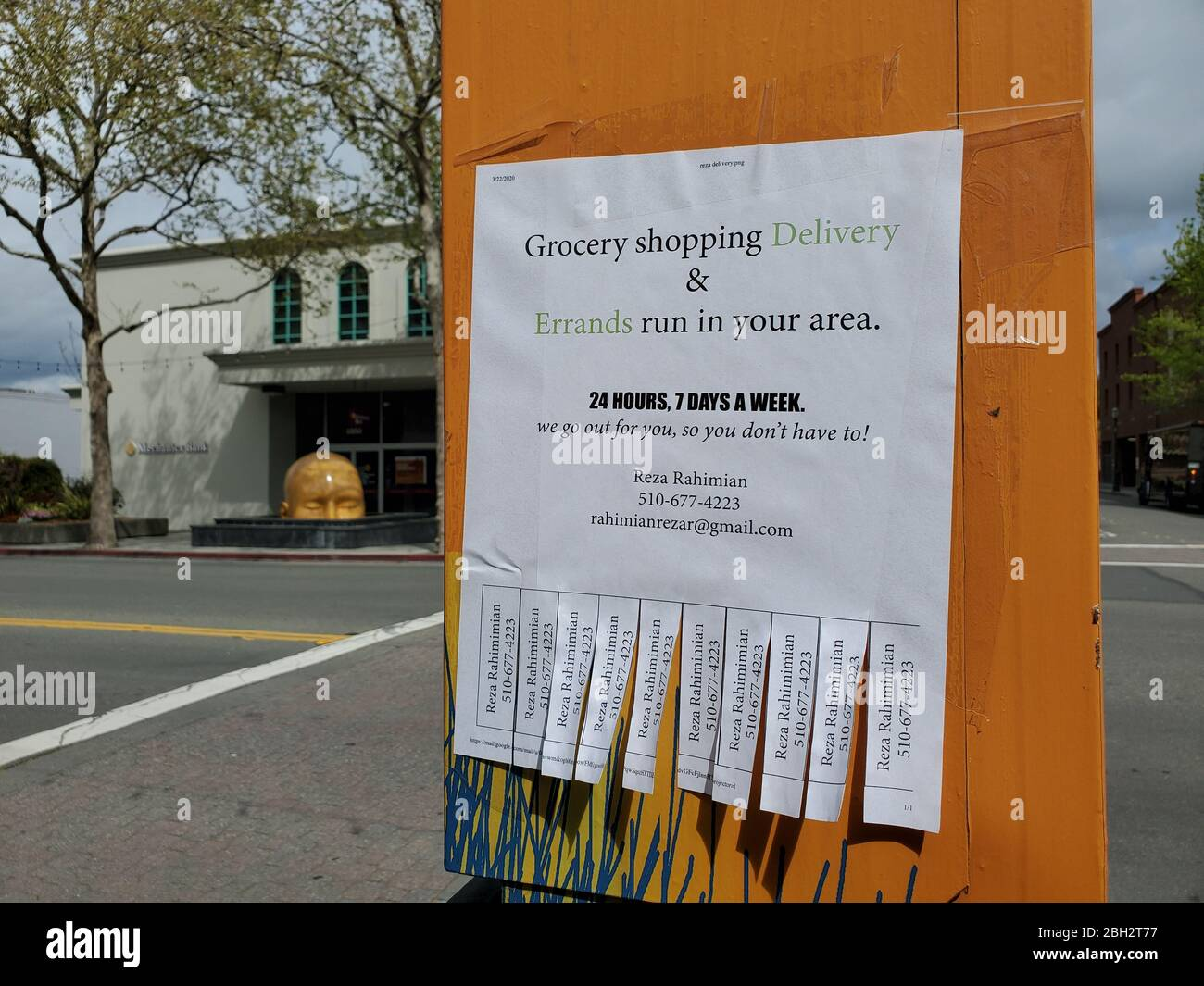 A sign with pulltabs provides details on a grocery shopping service during an outbreak of COVID-19 coronavirus in Walnut Creek, California, March 24, 2020. () Stock Photo