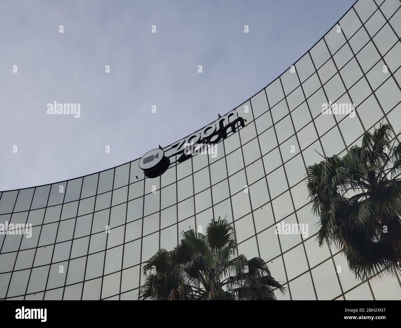 Facade with sign at headquarters of videoconferencing, remote work, and webinar technology company Zoom (ZM) in the Silicon Valley, San Jose, California, March 28, 2020. () Stock Photo