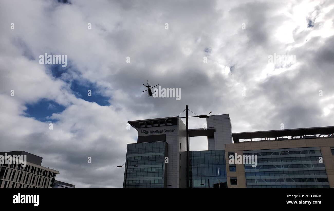 An emergency medical transport helicopter lifts off from a helipad atop the University of California San Francisco (UCSF) medical center during an outbreak of the COVID-19 coronavirus in San Francisco, California, March 30, 2020. () Stock Photo
