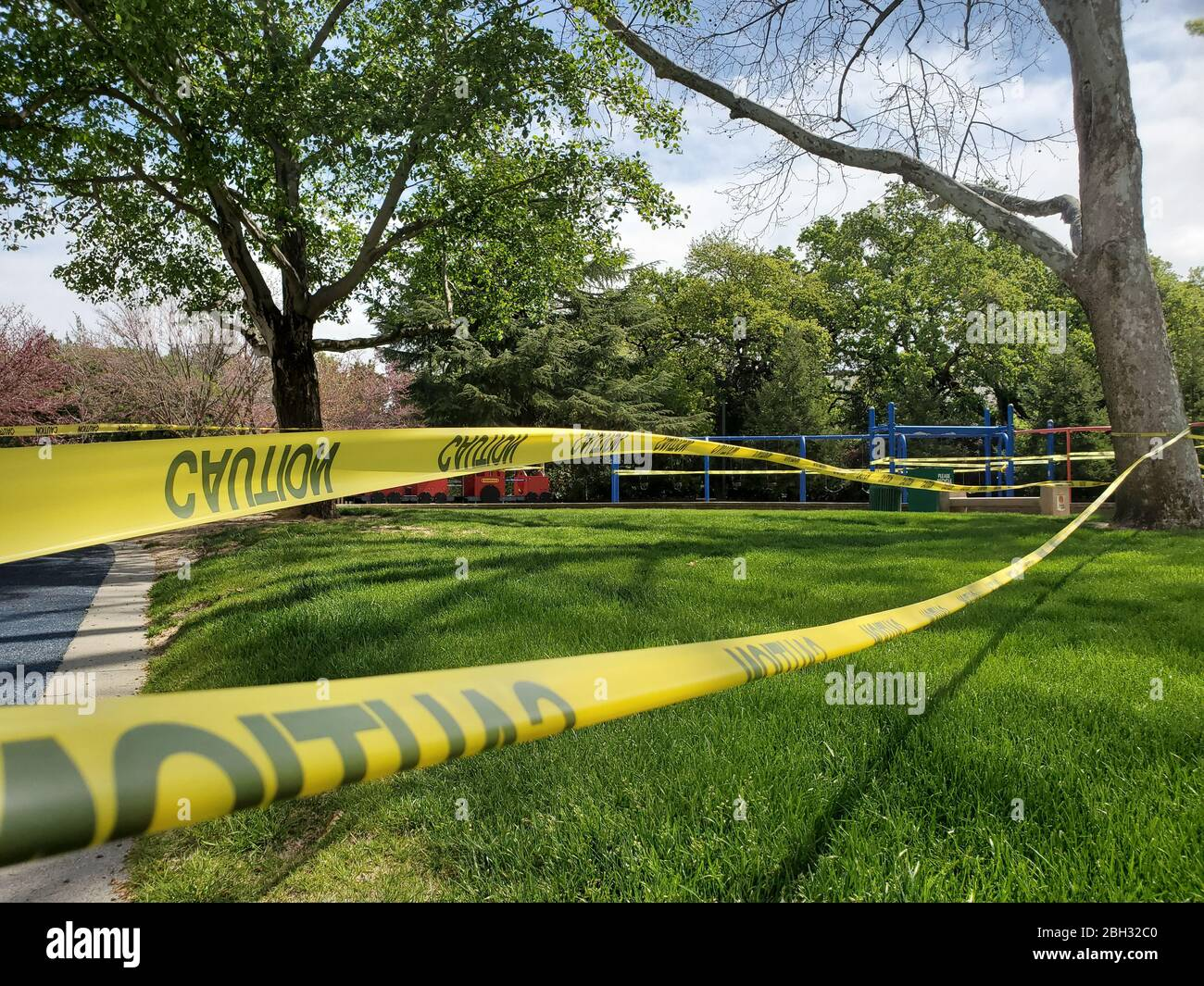 Caution tape and signs are visible at a closed playground during an outbreak of COVID-19 coronavirus in Walnut Creek, California, April 8, 2020. () Stock Photo