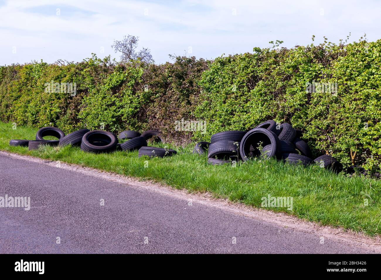 Northampton, UK. 23rd April 2020. Tyres dumped on the verge of a country lane close to Castle Ashby gardens, recycling centres were closed on the 21st April 2020 at 1800 due to the Coronavirus until further notice and already fly tipping is on the increase. Credit: Keith J Smith/Alamy Live News Stock Photo