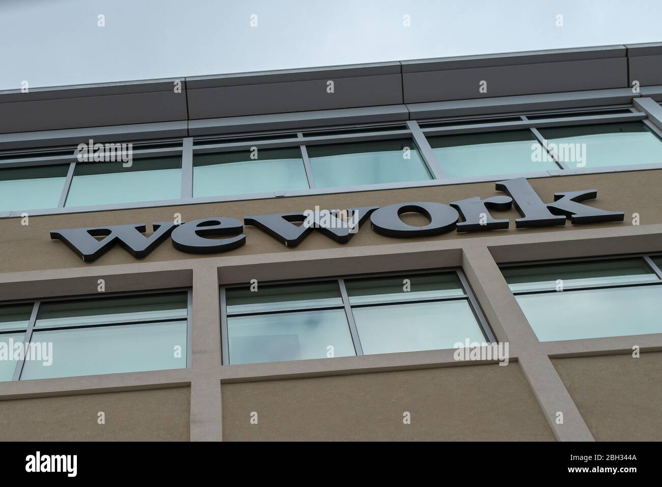 Low-angle view of logo for coworking company WeWork in the Silicon Valley, Redwood City, California, April 10, 2020. () Stock Photo