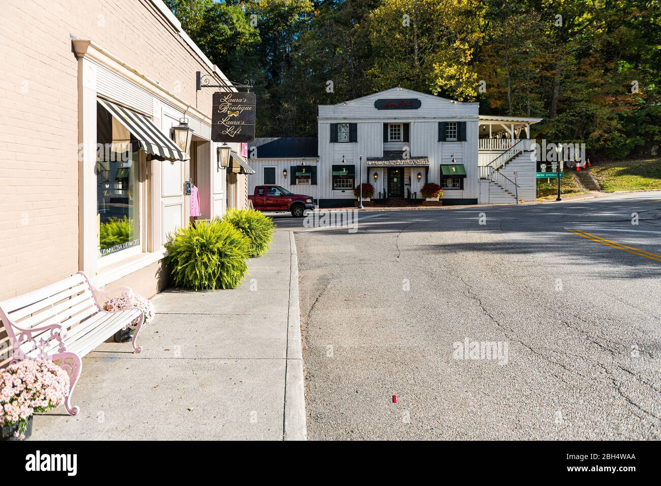 Hot Springs, USA - October 18, 2019: Historic downtown town empty street road in village city in Virginia countryside with old building architecture a Stock Photo