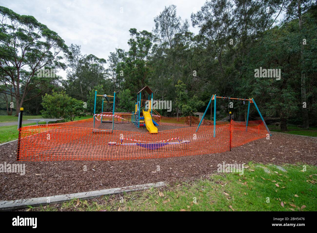 Due to COVID-19 pandemic, a public children's playground is closed and fenced off to the public. Stock Photo