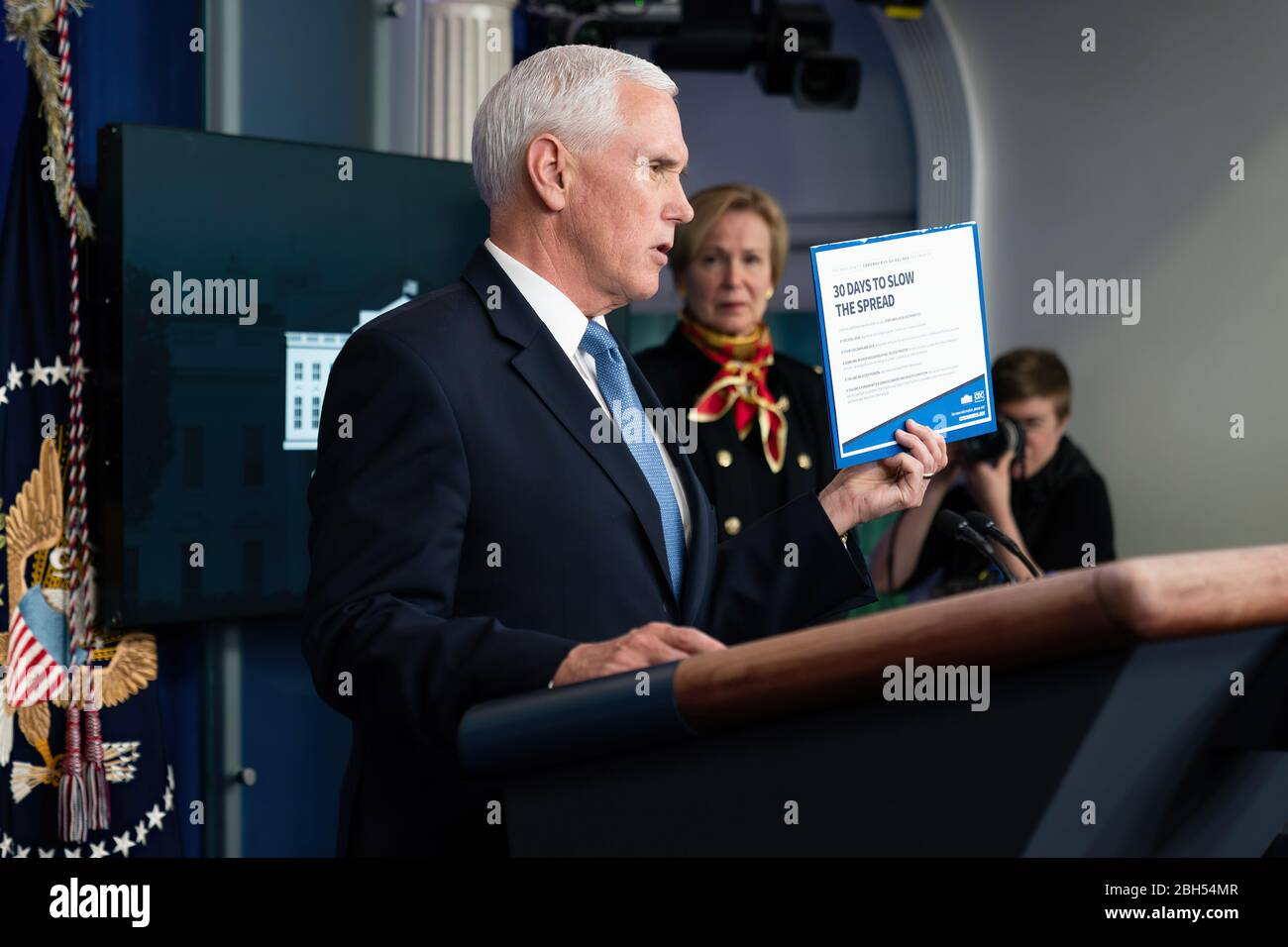 White House Coronavirus Update Briefing President Donald J. Trump listens as Vice President Mike Pence delivers remarks at a coronavirus update briefing Tuesday, March 31, 2020, in the James S. Brady Press Briefing Room of the White House. Stock Photo