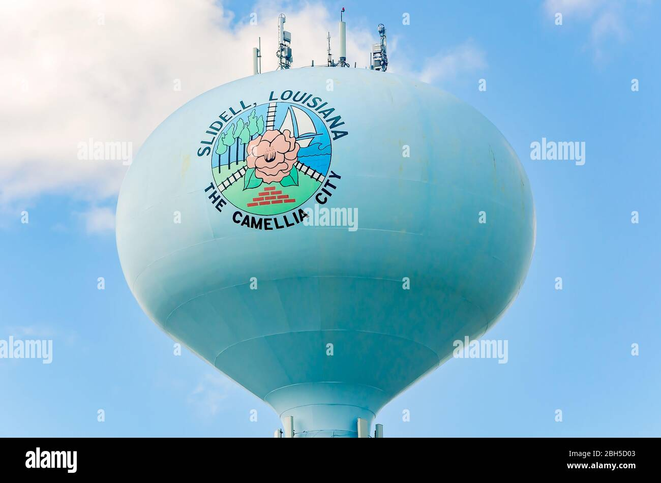 "The Slidell water tower features a camellia and proclaims the area as ""The Camellia City,"" April 20, 2020, in Slidell, Louisiana. Stock Photo"