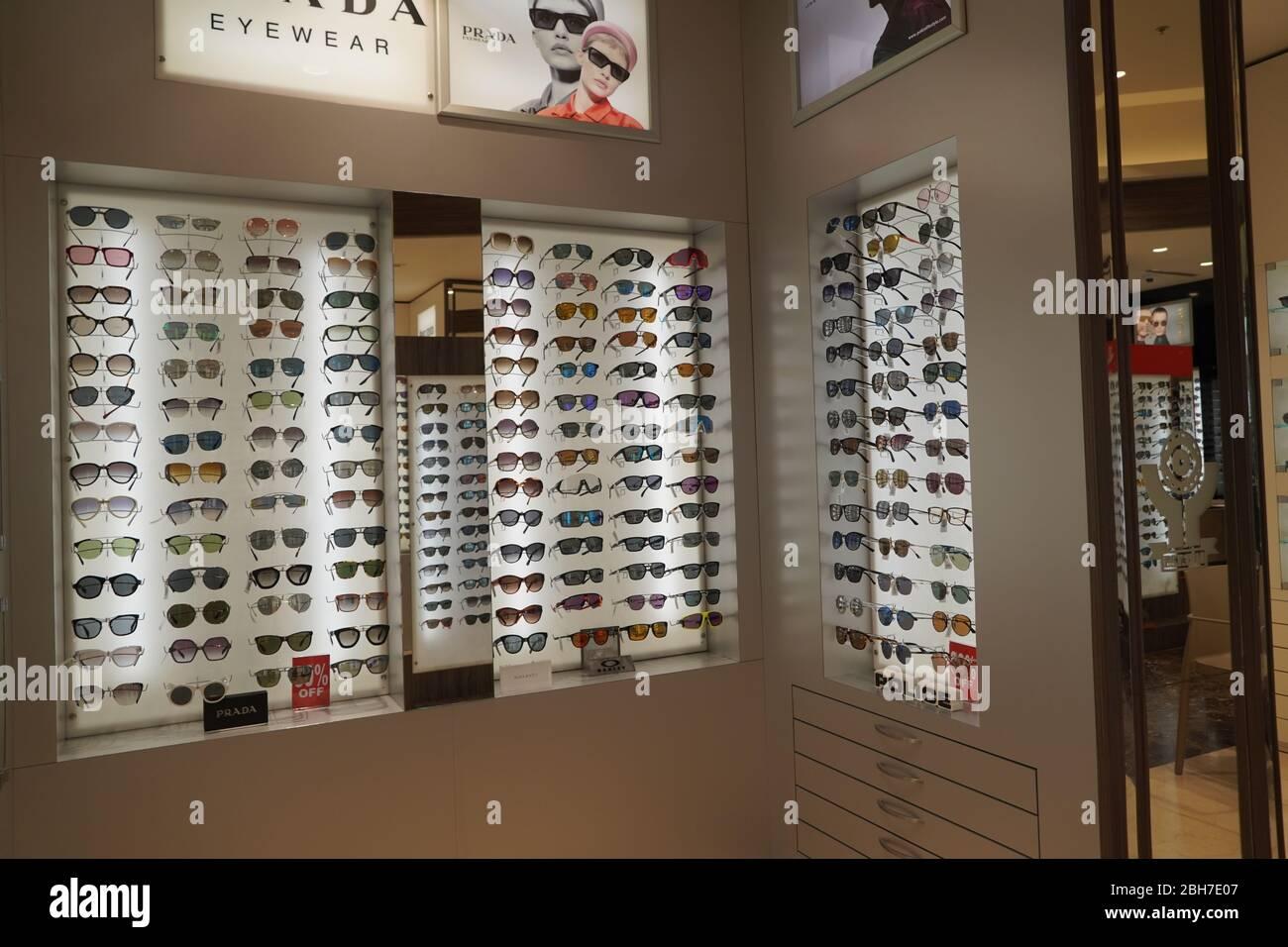 Dubai UAE December 2019 Sunglasses in a store. Sales rack of sunglasses. Prada, Dior, Roberto Cavalli, Ray Ban sunglasses. Close up of rows of sunglas Stock Photo