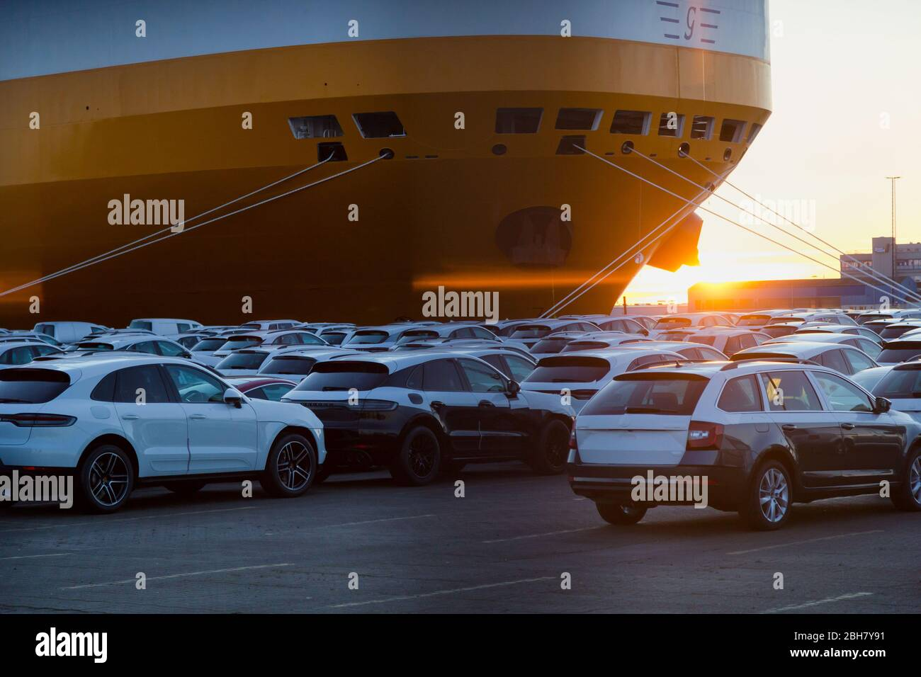 22.03.2020, Bremerhaven, Bremen, Germany - New cars are waiting for shipment on the BLG premises, in the picture carfeeder from Grimaldi Lines. 00A200 Stock Photo