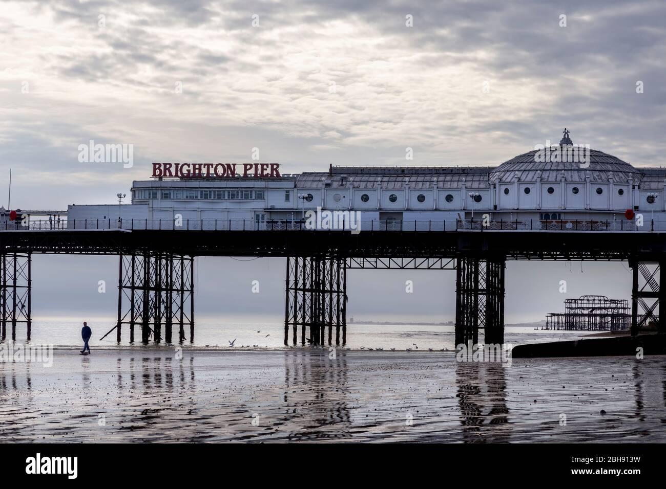 man alone at Brighton pier Stock Photo