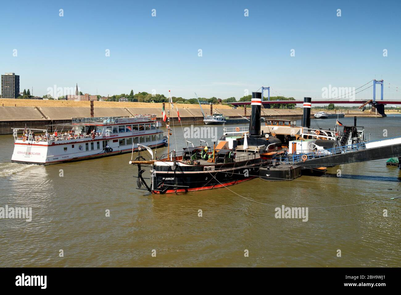 View of an excursion boat and the wheeled tug Oskar Huber, Museum Ship, Museum of German Inland Navigation, Duisburg-Ruhrort, Duisburg, North Rhine-Westphalia, Germany Stock Photo