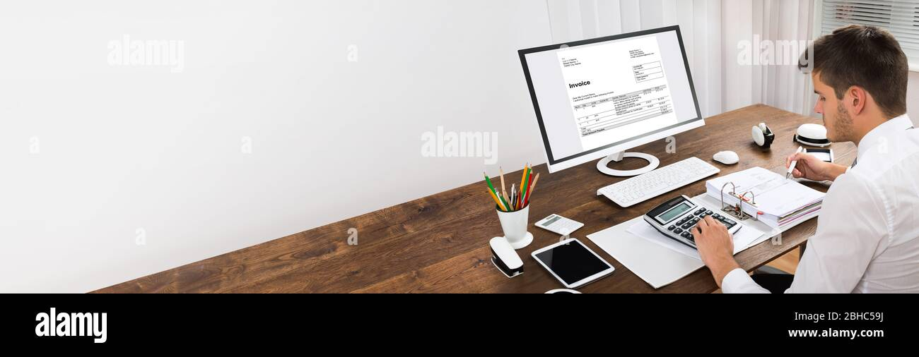 Invoice Calculator And Accounting Software On Computer Stock Photo Alamy