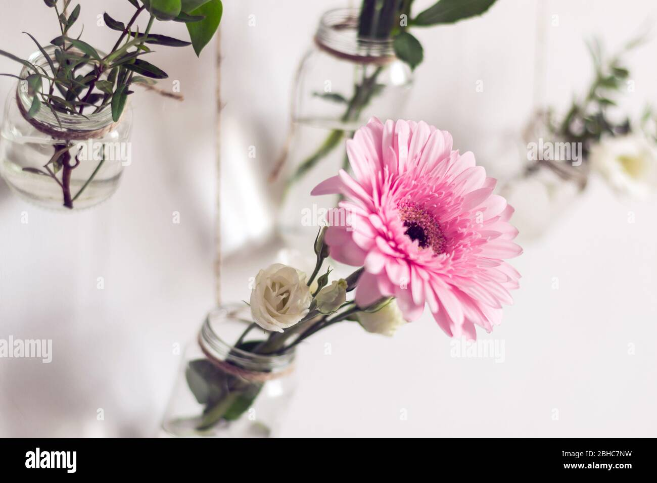 Beautiful Flowers Hang On White Wall Diy Home Natural Decor Old Glass Jars Are Reused As Flower Vases Stock Photo Alamy