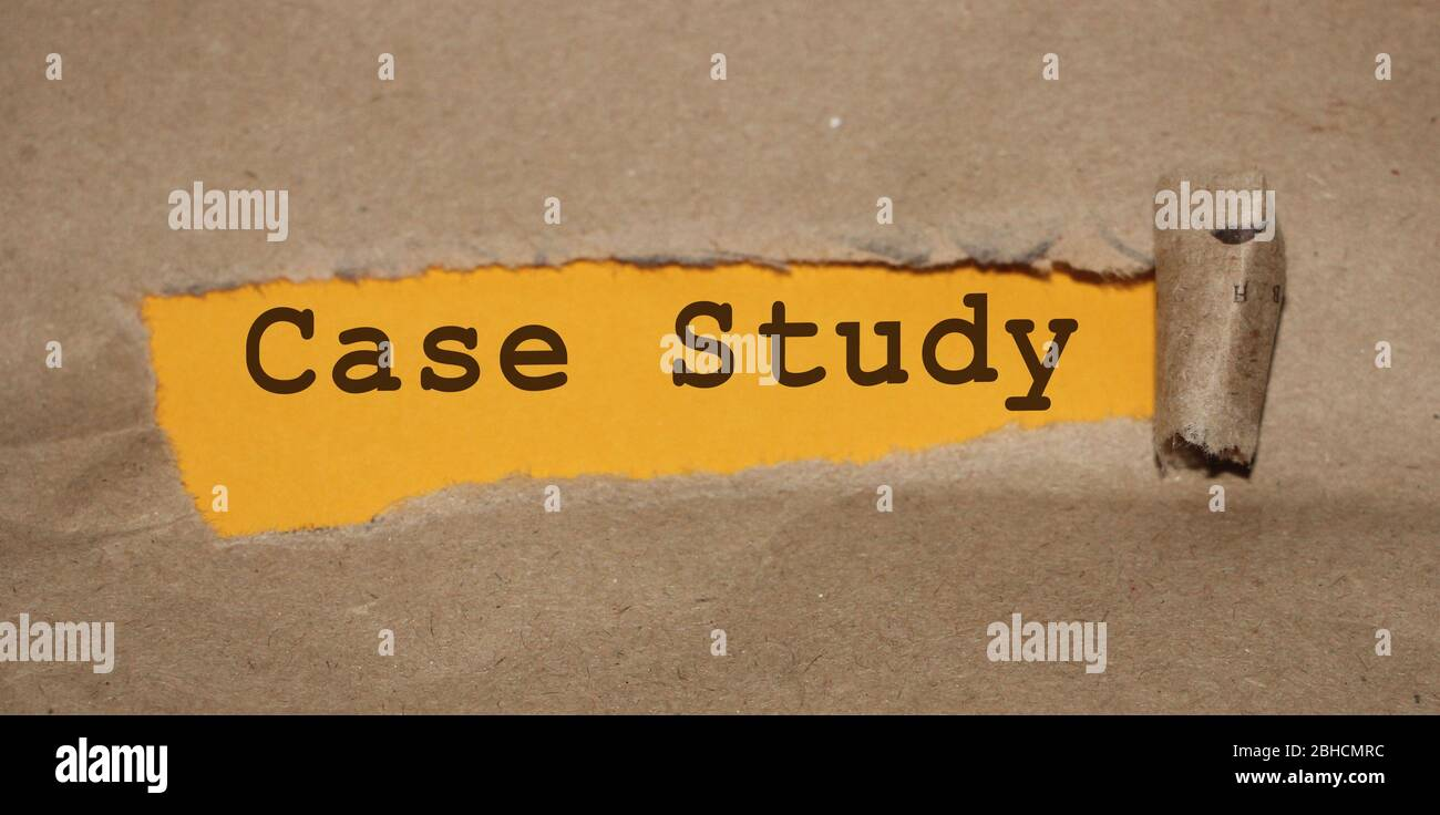 The text Case Study appearing behind torn brown paper Stock Photo