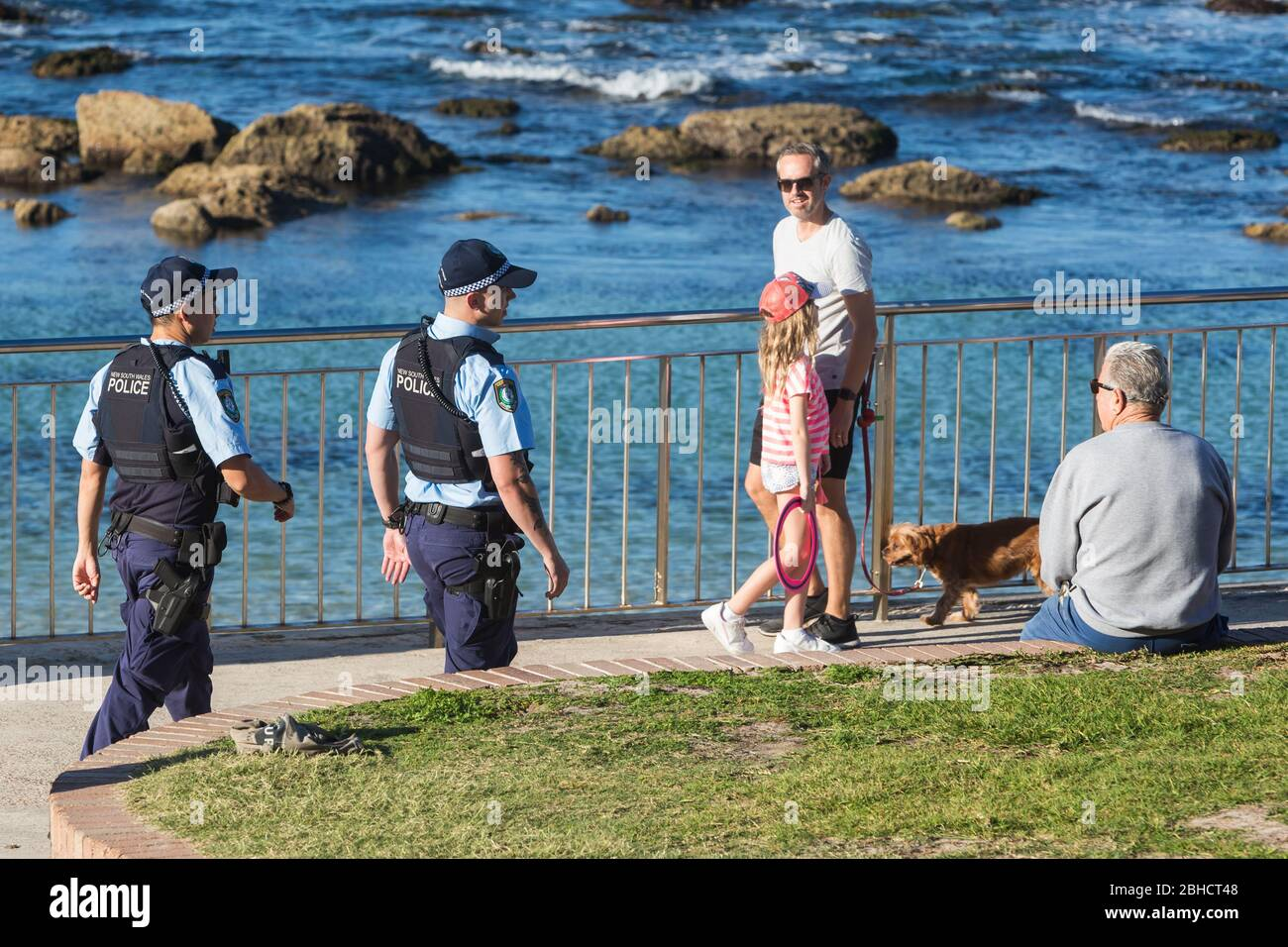 Sydney, Australia. Saturday 25th April 2020. Bronte Beach in Sydney's eastern suburbs is closed due to the COVIC-19 pandemic. Police moving on locals sitting down which is not allowed. Credit Paul Lovelace/Alamy Live News Stock Photo