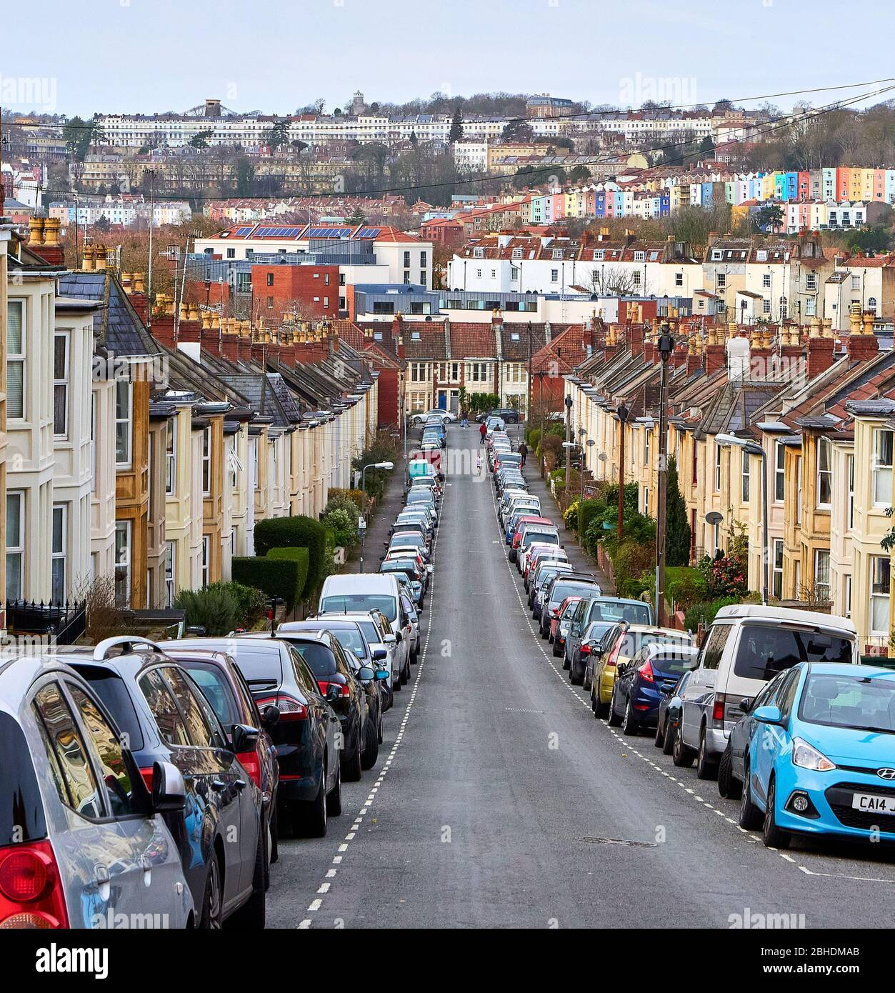 Steeply sloping street in Southville Bristol UK with views of Cliftonwood Royal York Crescent and the Suspension Bridge in Clifton Stock Photo