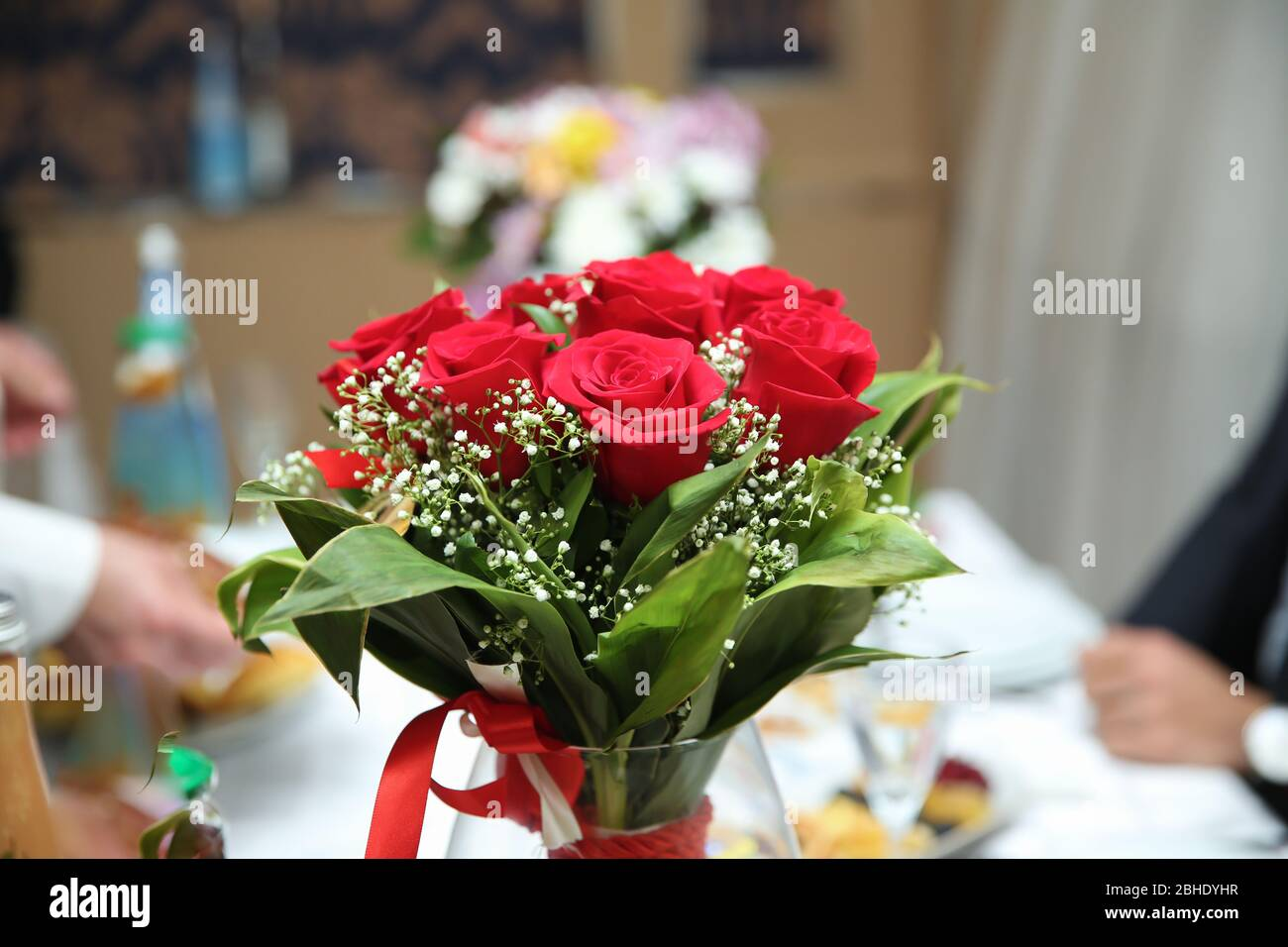 Red Rose Bouquet Beautiful Green Bouquet Of Red Flowers In A Glass Vase Red Wedding Bouquet In A Glass Jar Stock Photo Alamy