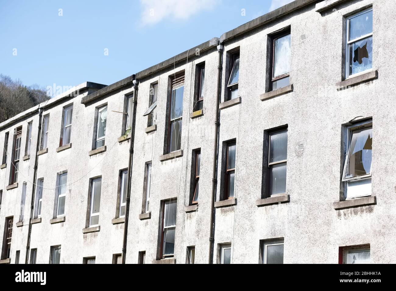 Derelict council house in poor housing estate slum with many social welfare issues in Port Glasgow Stock Photo