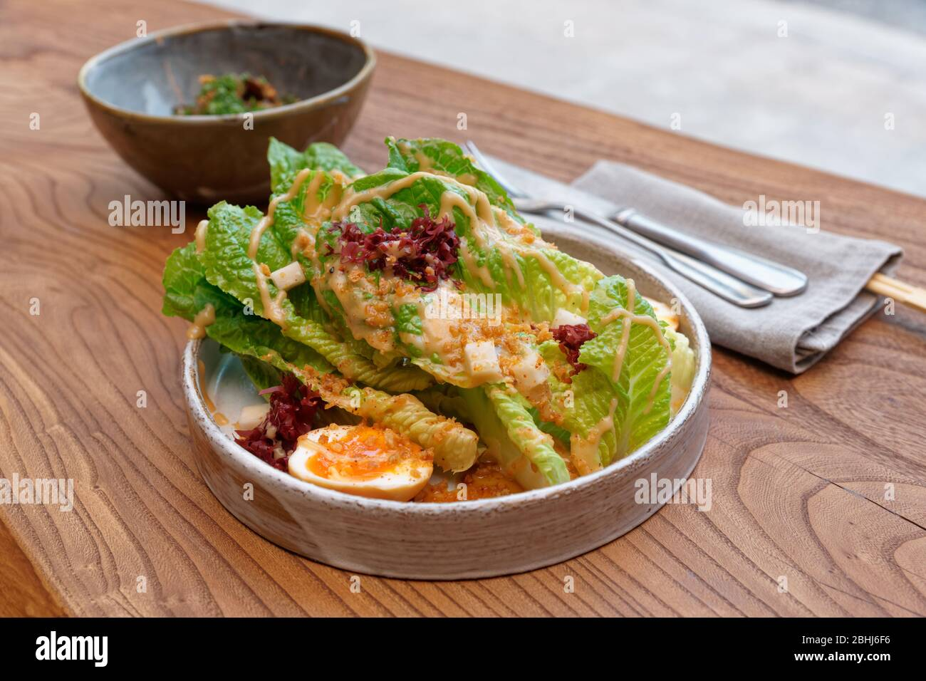 Caesar Salad Cooked In Asian Way Creative Fusion Food On Restaurant Table Stock Photo Alamy