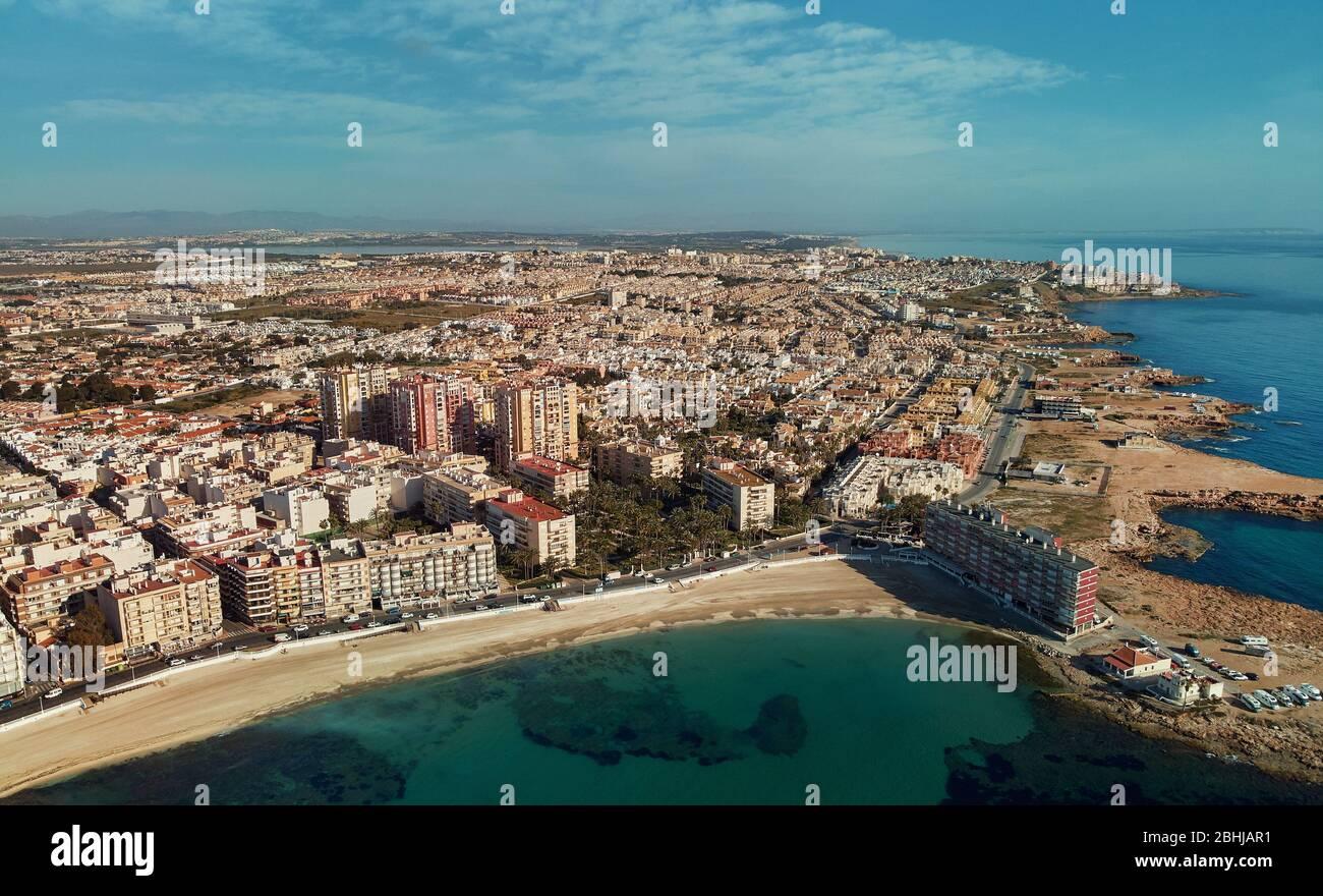 Distant aerial panorama Los Locos coastline, drone point of view, calm Mediterranean Sea, photo taken during corona virus lockdown beaches are closed. Stock Photo