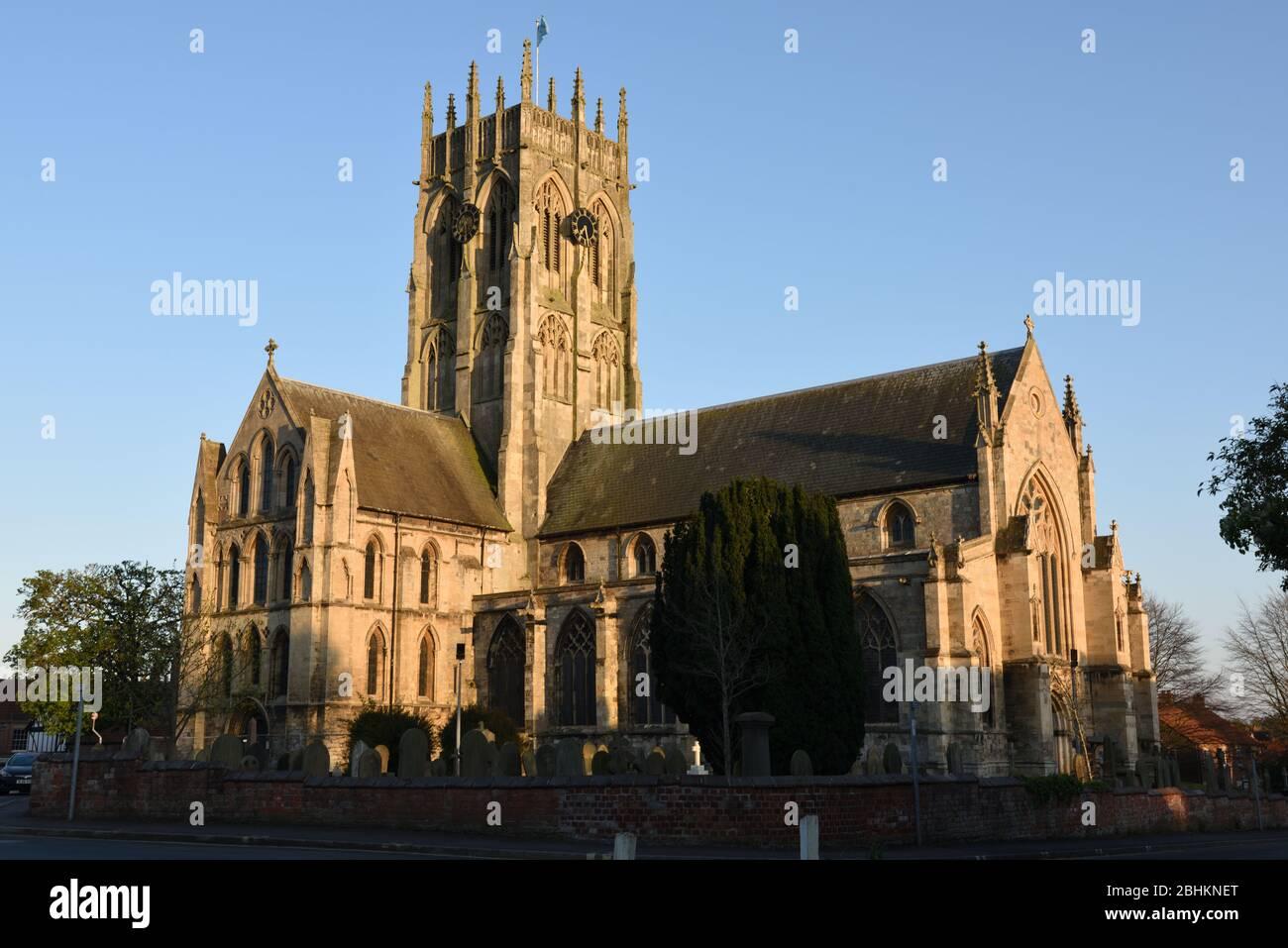 Evening sunlight illuminating St Augustine's Church, Hedon, East Yorkshire, England Stock Photo
