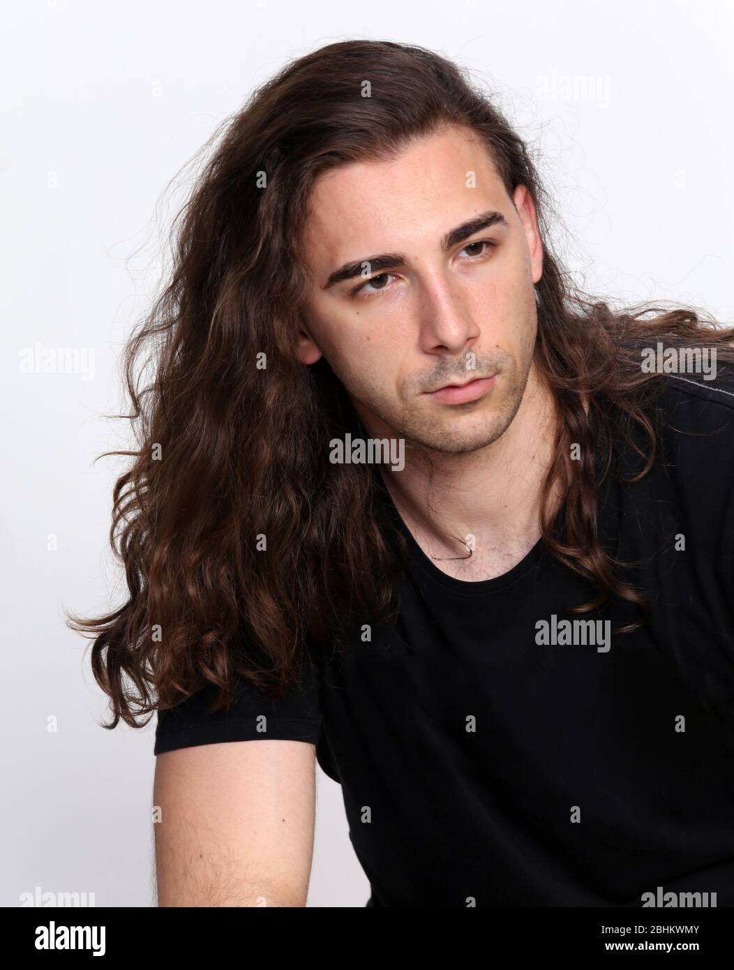 Stylish Male Model With Long Wavy Hair Posing In Studio Trends Style Fashion Concept Stock Photo Alamy