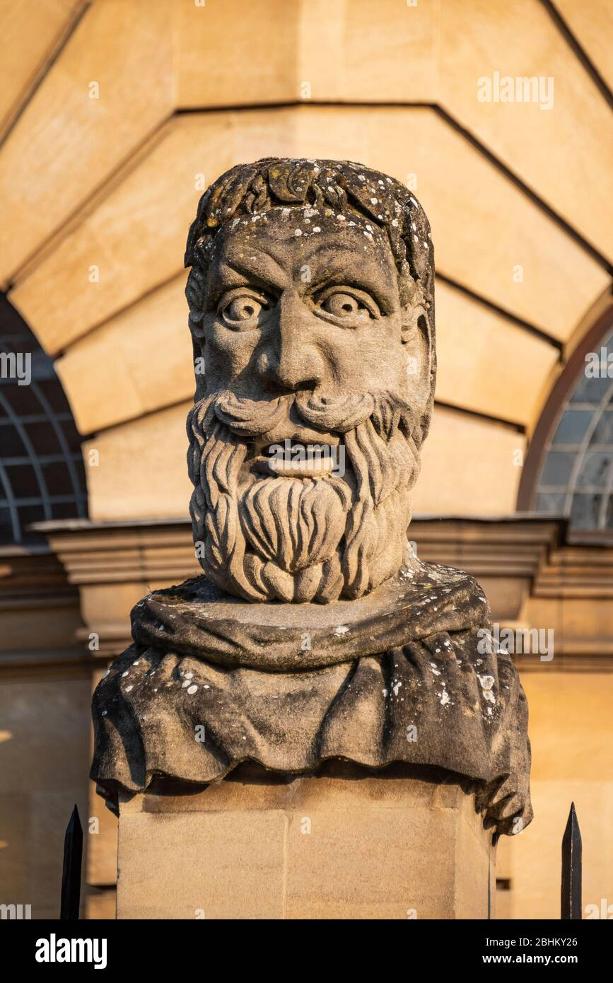 Carved stone head of an Emperor outside the Sheldonian Theatre, Oxford, UK Stock Photo