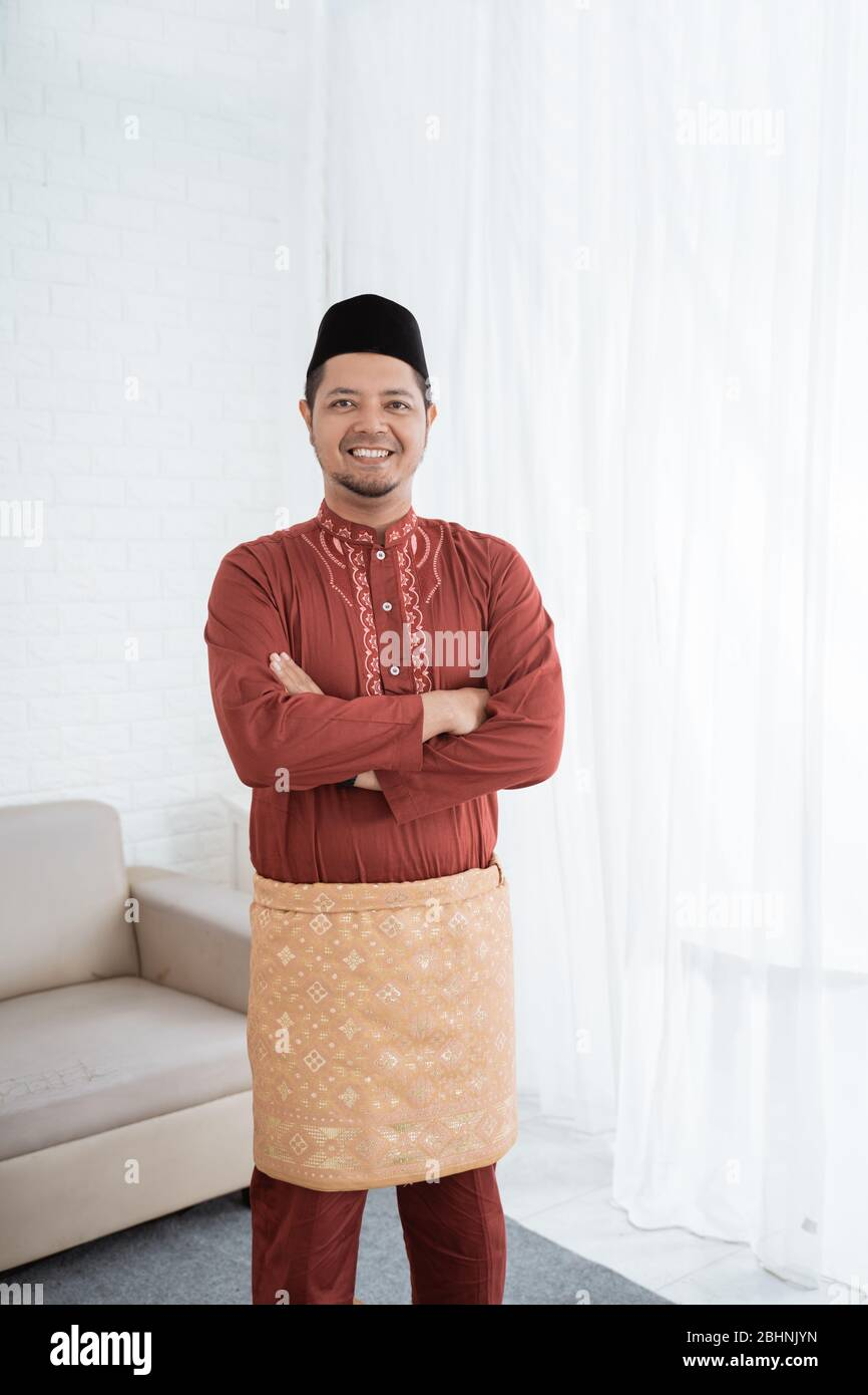 Muslim Male Smile Standing With Crossed Hands Wearing Traditional Malay Clothes Stock Photo Alamy